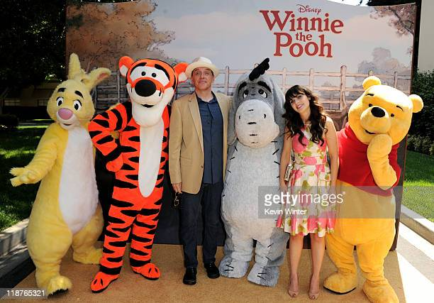 Voice actors Craig Ferguson and Zooey Deschanel pose with Rabbit Tigger Eeyore and Winnie the Pooh at the premiere of Walt Disney Pictures' 'Winnie...