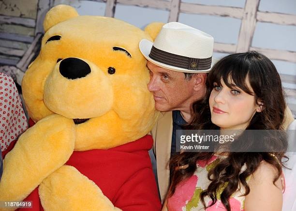 Voice actors Craig Ferguson and Zooey Deschanel pose with Winnie the Pooh at the premiere of Walt Disney Pictures' 'Winnie The Pooh' at the Walt...