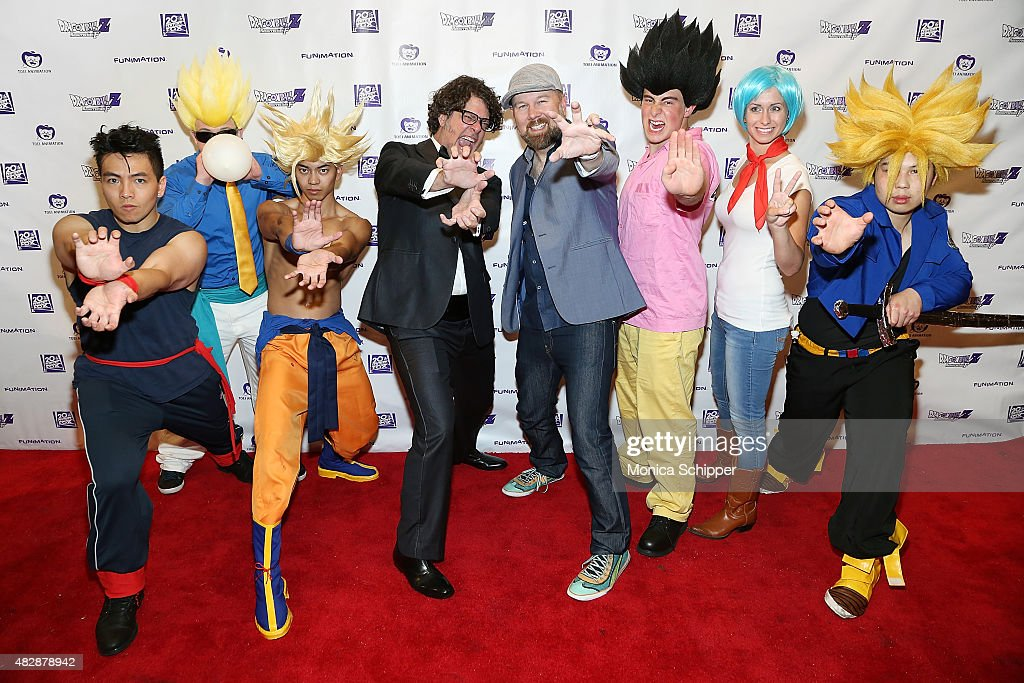Voice actors Sean Schemmel and Christopher Sabat pose for a photo with guets dressed as characters from the movie at the 'Dragon Ball Z Resurrection...
