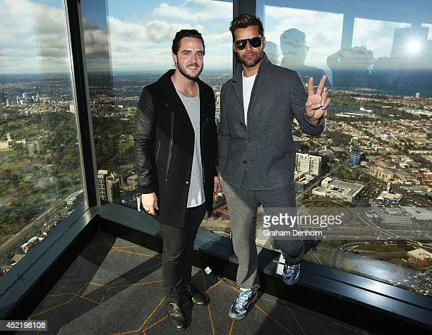 Voice finalist Jackson Thomas poses with Ricky Martin at a Grand Finale event held at Eureka Tower on July 16 2014 in Melbourne Australia