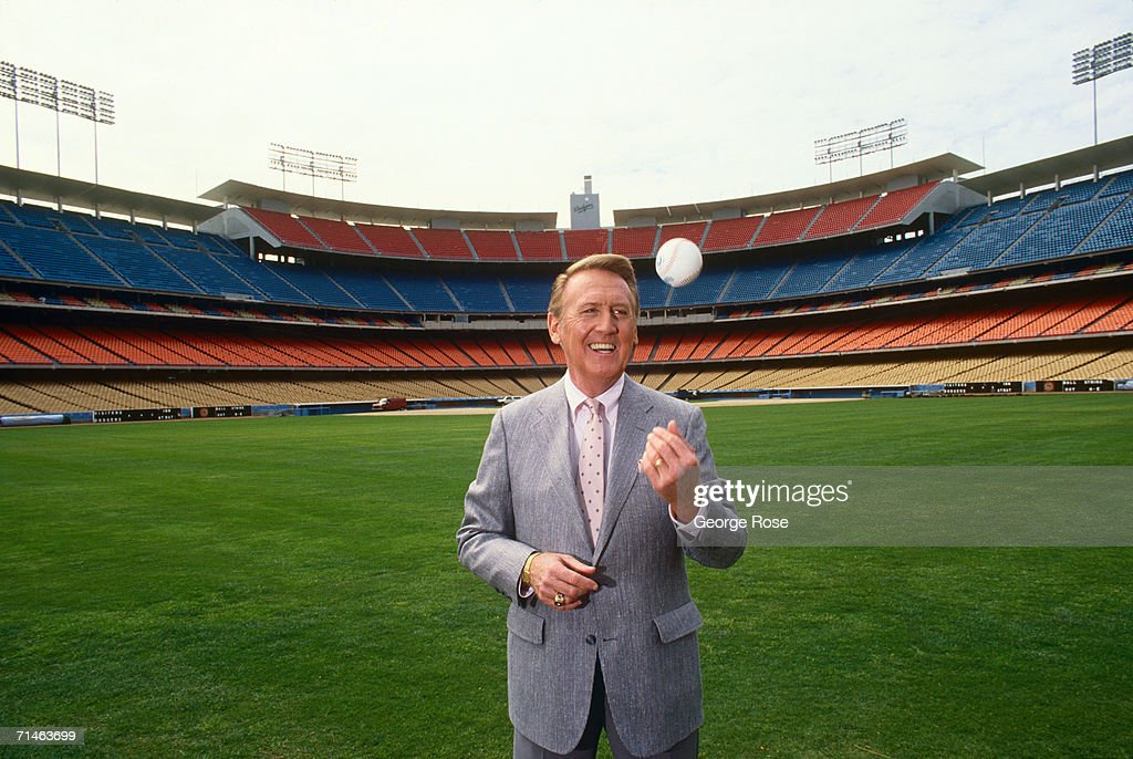 Voice of the Los Angeles Dodgers radio broadcasts Vin Scully poses in the outfield of Dodger Stadium during a 1990 Los Angeles California photo...