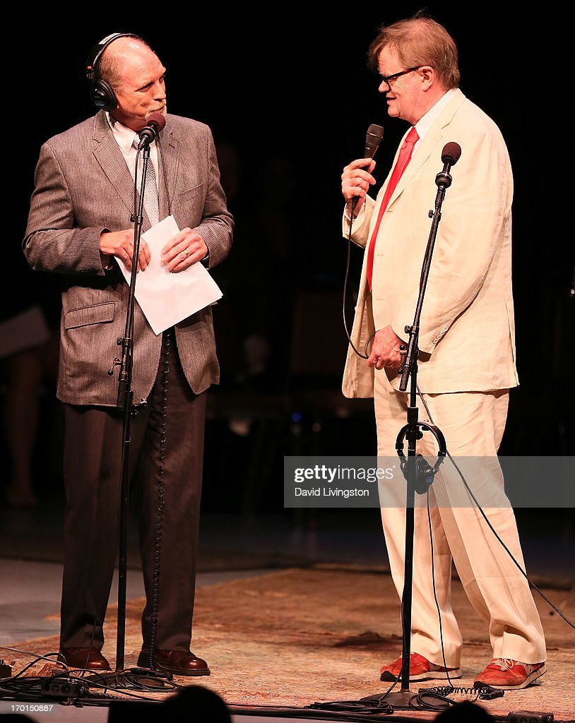 Voice talent Tim Russell (L) and radio personality <a gi-track='captionPersonalityLinkClicked' href=/galleries/search?phrase=Garrison+Keillor&family=editorial&specificpeople=594099 ng-click='$event.stopPropagation()'>Garrison Keillor</a> of A Prairie Home Companion perform on stage at the Greek Theatre on June 7, 2013 in Los Angeles, California.