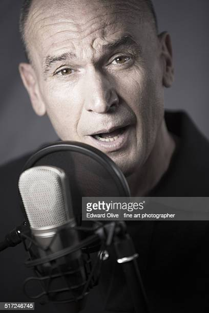 Voiceover actor and microphone in recording studio