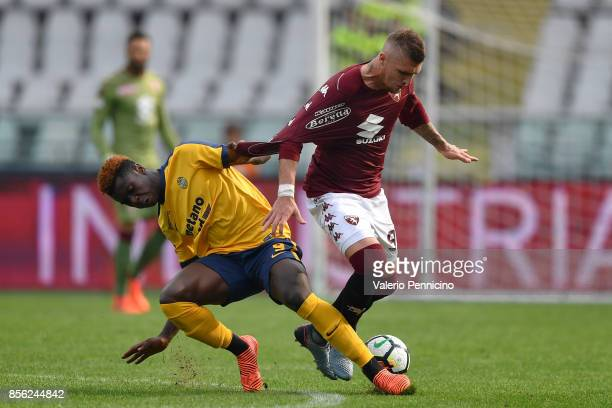 Vojnovic Lyanco of Torino FC is pulled by his shirt by Bioty Moise Kean of Hellas Verona FC during the Serie A match between Torino FC and Hellas...