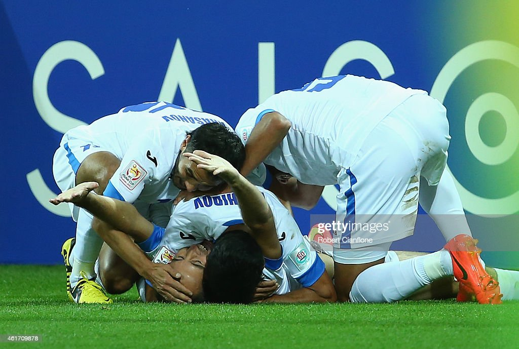 Vokhid Shodiev of Uzbekistan celebrates with team mates after he scored a goal during the 2015 Asian Cup match between Uzbekistan and Saudi Arabia at...