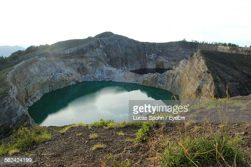 Volcanic Crater Filled With Clear Turquoise Water