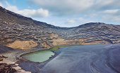 Volcanic landscape with lake, Lanzarote, Canary Islands, Spain