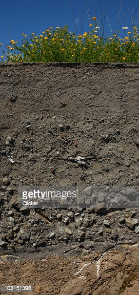 Volcanic Layers Display Showing Ash, Rock and Dirt : Stock Photo