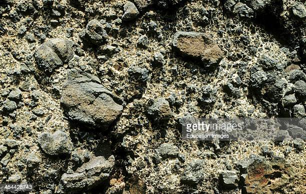 Volcanic or pillow breccia Composed of angular basalt from broken pillows and volcanic ash cemented by white calcite CaCO3 Angular clasts Cape...