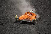 A guy is doing volcano boarding in the Cerro Negro of Nicaragua