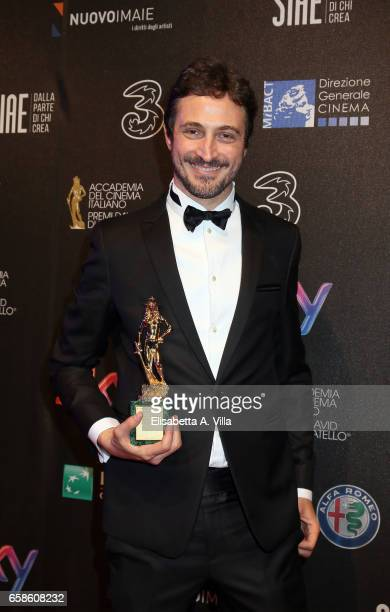 Volfango De Biasi poses with his Best Documentary Feature for 'Crazy for football' during the 61 David Di Donatello ceremony on March 27 2017 in Rome...