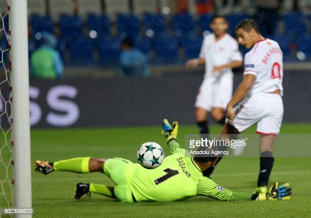 Volkan Babacan of Medipol Basaksehir in action against Wissam Ben Yedder of Sevilla FC during the UEFA Champions League playoff match between Medipol...
