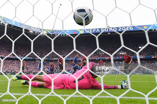 Volkan Babacan of Turkey dives in vain as Luka Modric of Croatia scores his team's first goal during the UEFA EURO 2016 Group D match between Turkey...