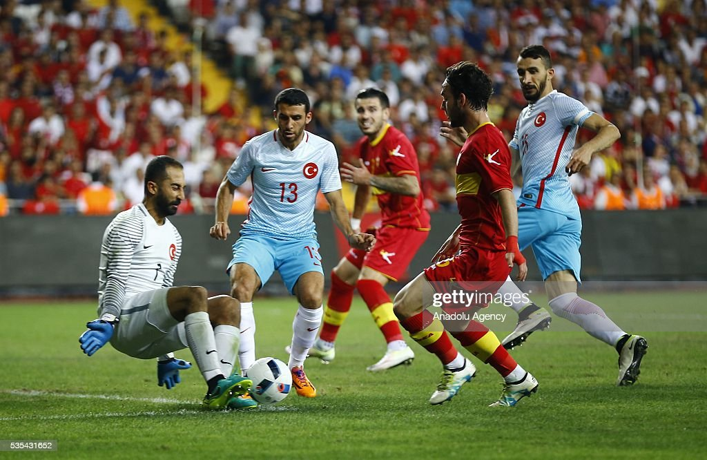 Volkan Babacan (R) of Turkey in action during the friendly football match between Turkey and Montenegro at Antalya Ataturk Stadium in Antalya, Turkey on May 29, 2016.