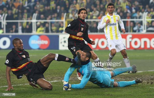 Volkan Demirel of Fenerbahce battles with Seydou Keita of Sevilla during the UEFA Champions League First Knock Out Round First Leg match between...