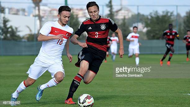 Volkan Egri of Turkey vies with Dominik Franke of Germany during the U18 four nations friendly tournament match between Turkey and Germany at Emirhan...