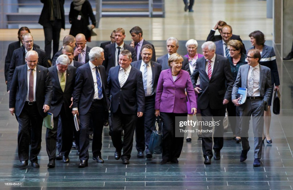 Volker Kauder, Chairman of the CDU/CSU parliamentary group in the Bundestag, Minister-president of Hesse <a gi-track='captionPersonalityLinkClicked' href=/galleries/search?phrase=Volker+Bouffier&family=editorial&specificpeople=2371294 ng-click='$event.stopPropagation()'>Volker Bouffier</a> (CDU), German Transport Minister <a gi-track='captionPersonalityLinkClicked' href=/galleries/search?phrase=Peter+Ramsauer&family=editorial&specificpeople=770626 ng-click='$event.stopPropagation()'>Peter Ramsauer</a>, German Christian Democratic Union ( CDU ) General Secretary Hermann Groehe, German Interior Minister <a gi-track='captionPersonalityLinkClicked' href=/galleries/search?phrase=Hans-Peter+Friedrich&family=editorial&specificpeople=7528072 ng-click='$event.stopPropagation()'>Hans-Peter Friedrich</a>, German Chancellor Angela Merkel, Chairman of the Christian Social Union of Bavaria (CSU), <a gi-track='captionPersonalityLinkClicked' href=/galleries/search?phrase=Horst+Seehofer&family=editorial&specificpeople=4273631 ng-click='$event.stopPropagation()'>Horst Seehofer</a>, and CSU (Christian Social Union) secretary general Alexander Dobrindt arrive for German Green Party and German Christian Democrats coalition talks at German Bundestag on October 10, 2013 in Berlin, Germany.