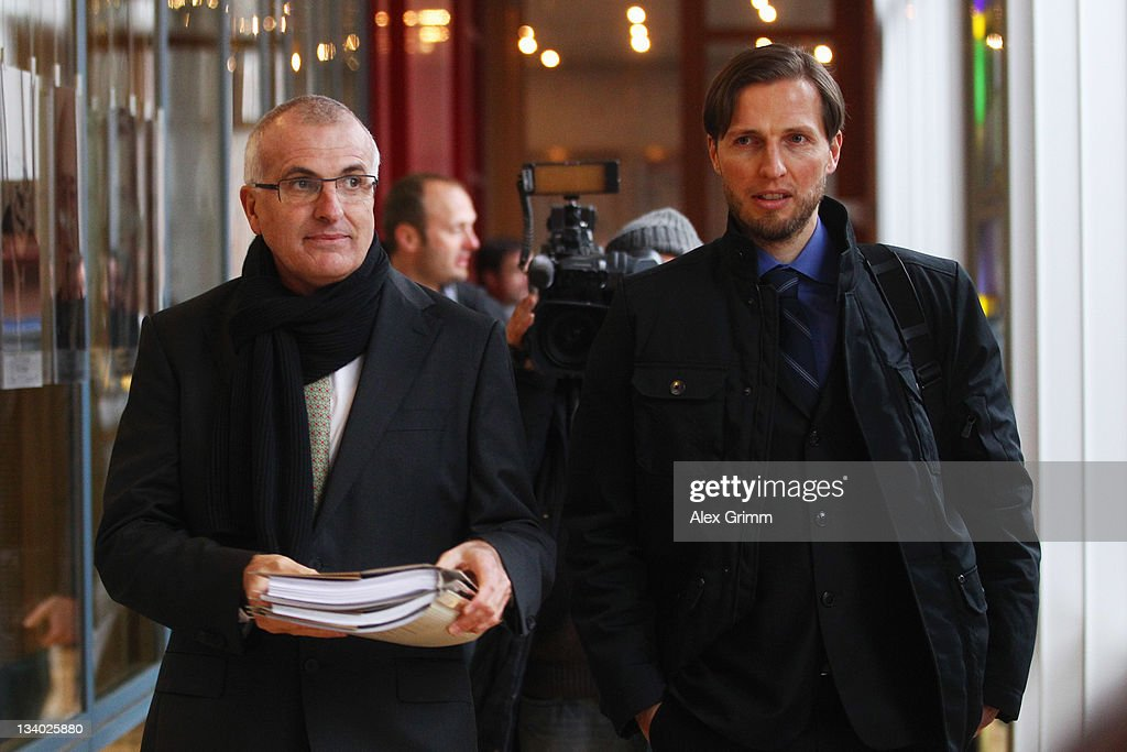 Volker Oppitz director of Dynamo Dresden and lawyer Christoph Schickhardt arrive for their DFB Court trial at the DFB headquarter on November 24 2011...