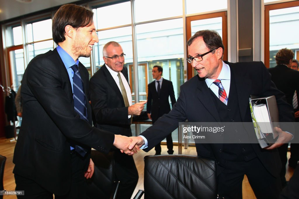 Volker Oppitz director of Dynamo Dresden and lawyer Christoph Schickhardt shake hands with Hans E Lorenz prior to their DFB Court trial at the DFB...