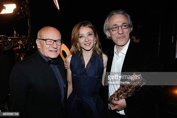 Volker Schloendorff and Screenwriter Cyril Gely pose backstage with Sylvie Testud after they received the award for the Best Adapted Screenplay for...