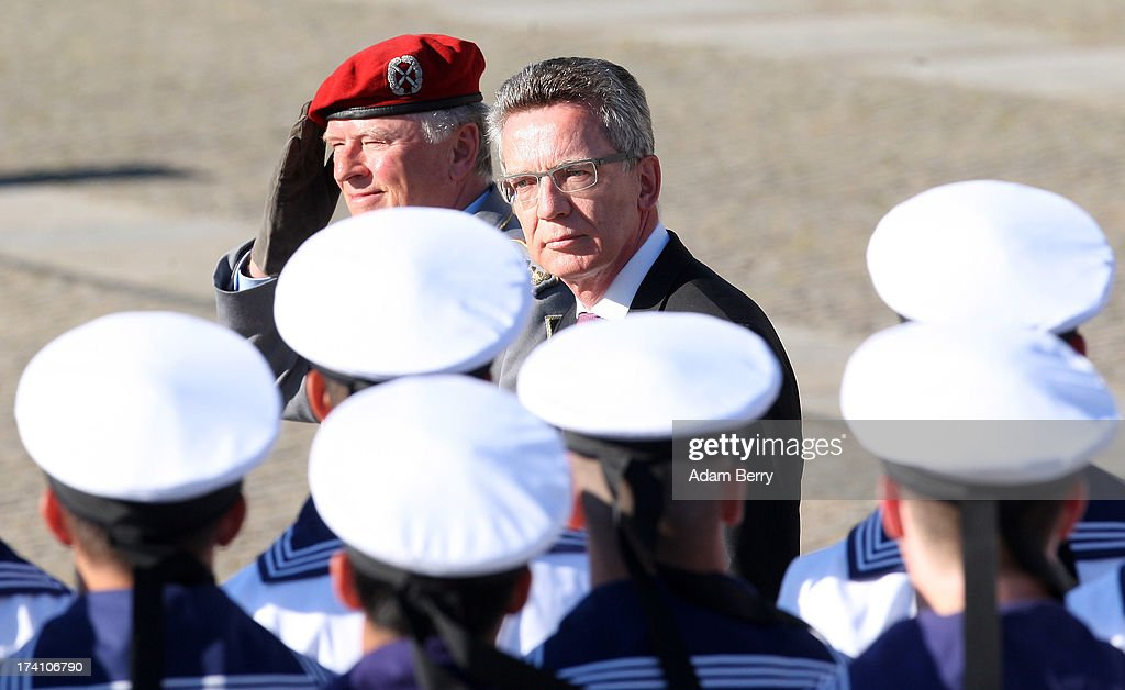 Volker Wieker, chief of staff (Generalinspekteur) of the Bundeswehr (L), and German Defense Minister <a gi-track='captionPersonalityLinkClicked' href=/galleries/search?phrase=Thomas+de+Maiziere&family=editorial&specificpeople=618845 ng-click='$event.stopPropagation()'>Thomas de Maiziere</a> review new German Bundeswehr soldiers during a swearing-in ceremony for new recruits of the Bundeswehr, the armed forces of the Federal Republic of Germany, in front of the Reichstag building on July 20, 2013 in Berlin, Germany. In the annual ceremony, new soldiers take office on the anniversary of the assassination attempt on Adolf Hitler by Claus Schenk Graf von Stauffenberg.