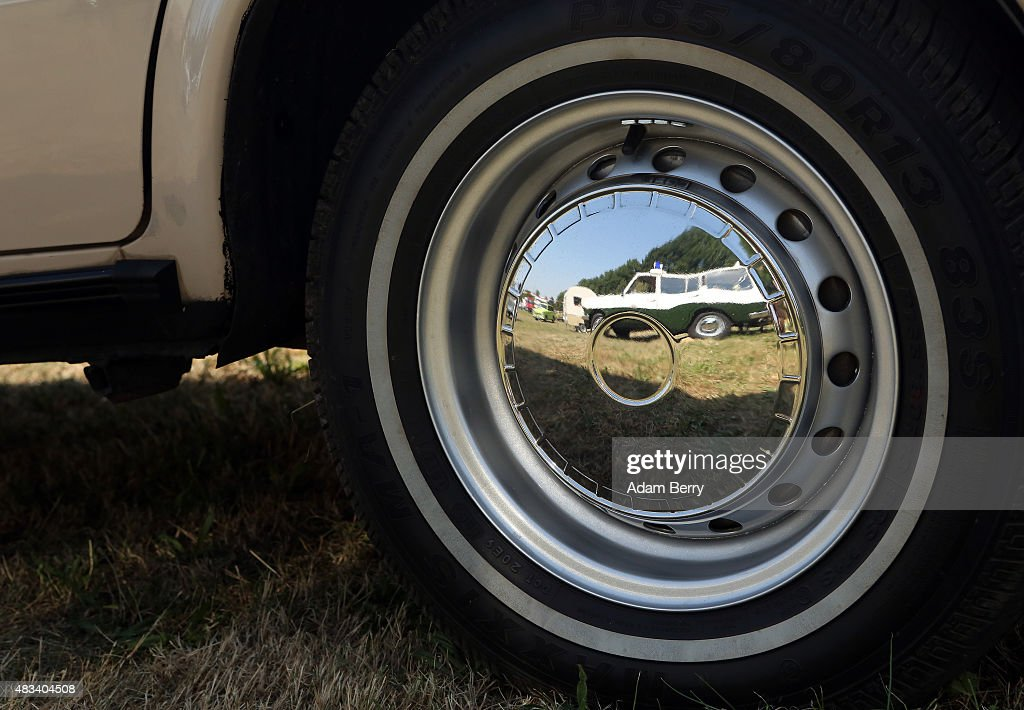 Volkspolizei East German Wartburg automobile is reflected in the hubcap of a Trabant automobile at a Trabant enthusiasts' weekend on August 8 2015...