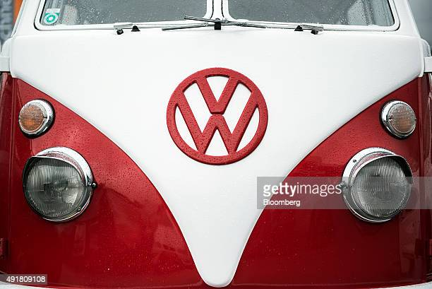 A Volkswagen AG badge sits on a Volkswagen Split Screen Camper van automobile displayed on the forecourt of a dealership in Vienna Austria on...