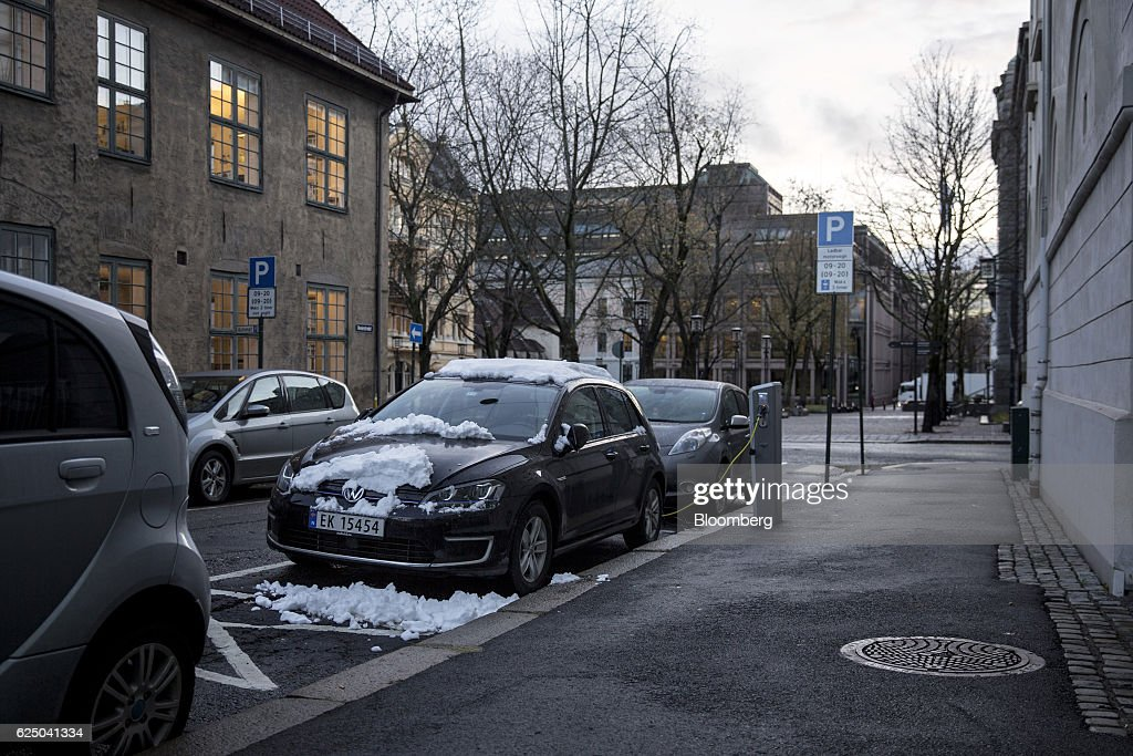 A Volkswagen AG (VW) e-Golf electric vehicle (EV) charges at a charging station in Revierstredet in Oslo, Norway, on Monday, Nov. 21, 2016. The International Energy Agency forecasts that global gasoline consumption has all but peaked as more efficient cars and the advent of electric vehicles from new players such as Tesla Motors Inc. halt demand growth in the next 25 years. Photographer: Fredrik Bjerknes/Bloomberg via Getty Images