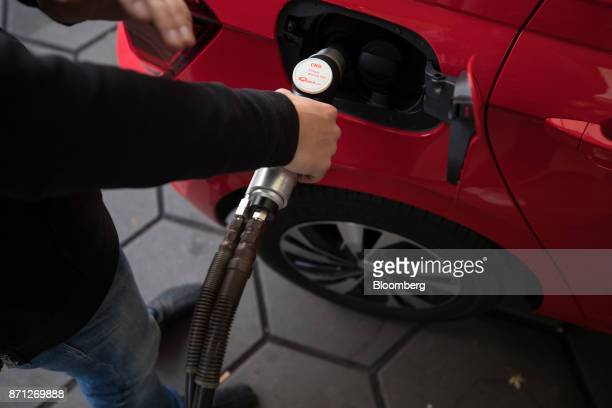 A Volkswagen AG Polo TGI automobile is filled with compressed natural gas on a petrol station forecourt during the VW CNG Mobility Day in Essen...
