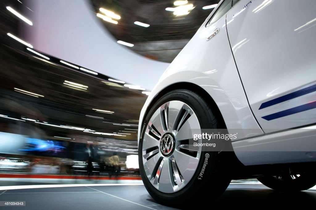 A Volkswagen AG (VW) Twin-Up! vehicle stands on a revolving display platform in this long-exposure photograph taken at the 43rd Tokyo Motor Show 2013 in Tokyo, Japan, on Thursday, Nov. 21, 2013. The autoshow will be open to the public from Nov. 23 to Dec. 1 at the Tokyo International Exhibition Center, also known as the Tokyo Big Sight. Photographer: Kiyoshi Ota/Bloomberg via Getty Images