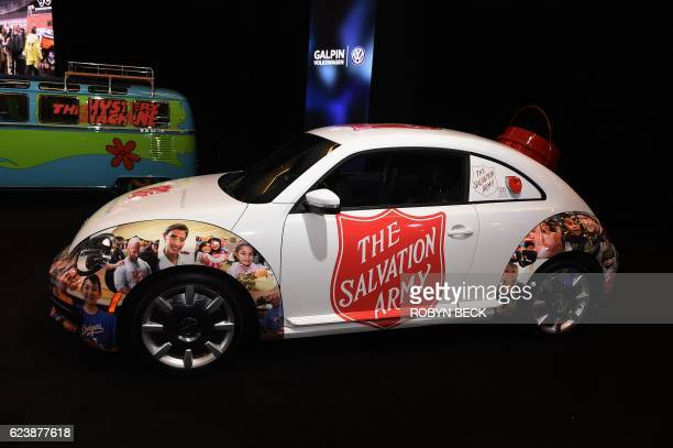 A Volkswagen Beetle customized for the Salvation Army featuring a builtin cash donation bucket on the back and a credit card reader on the window...