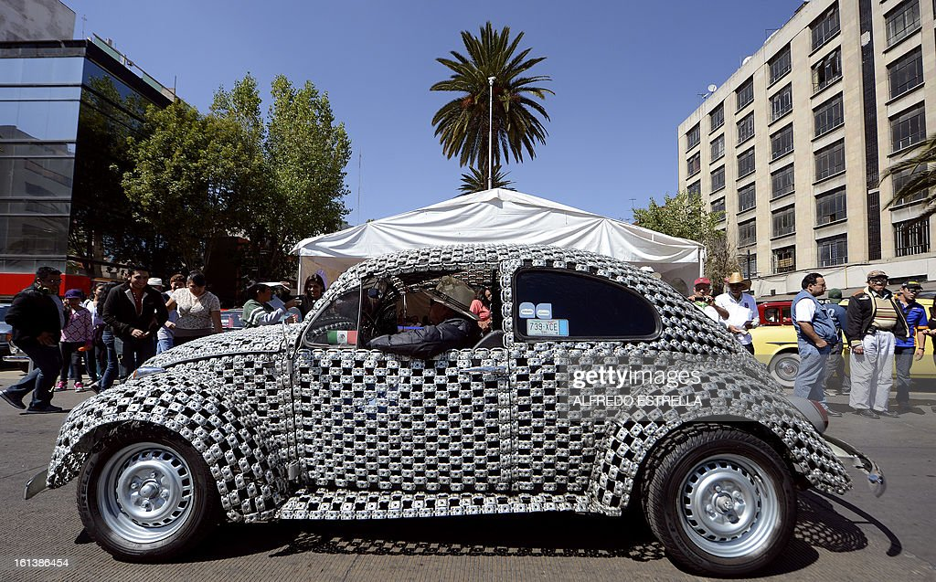 A VolksWagen Beetle is seen during a Classic Cars exhibit at the Revolution Monument in Mexico City, on February 10, 2013. It is the first time classic cars are showed in an exhibit for general public in Mexico City. AFP PHOOTO/Alfredo Estrella