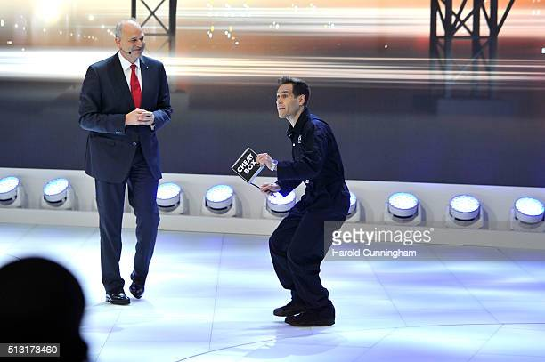 Volkswagen Board member Juergen Stackmann looks on as comedian Simon Brodkin disrupts the Volkswagen press conference during the n March 1 2016 in...
