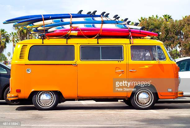 Volkswagen Bus with surf boards.