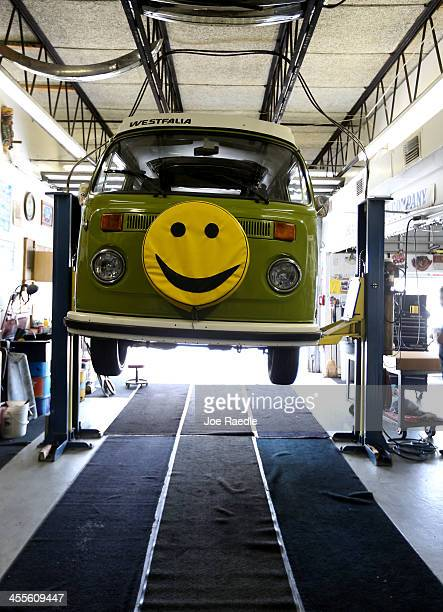 Volkswagen camper is seen on the lift at McNab Foreign Car garage that specializes in restoring VW vehicles on December 12 2013 in Pompano Beach...