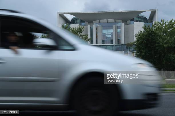 Volkswagen car drives past the Chancellery on July 24 2017 in Berlin Germany Three of Germany's biggest carmakers including Daimler which owns the...