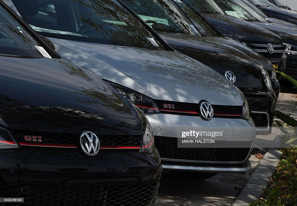 Volkswagen cars at a dealership in Los Angeles, California on June 28, 2016. Volkswagen has agreed to pay out $14.7 billion in a settlement with US authorities and car owners over its emissions-cheating diesel-powered cars. The settlement filed in federal court calls for the German auto giant to either buy back or fix the cars that tricked pollution tests, and to pay each owner up to $10,000 in cash. / AFP / Mark Ralston