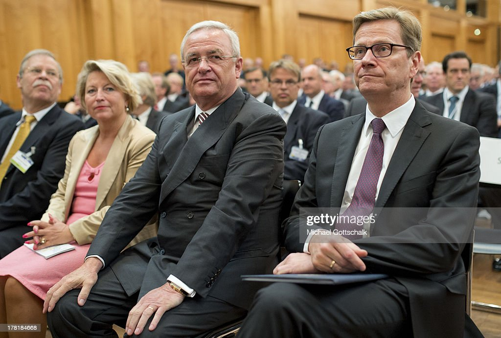 Volkswagen CEO <a gi-track='captionPersonalityLinkClicked' href=/galleries/search?phrase=Martin+Winterkorn&family=editorial&specificpeople=840091 ng-click='$event.stopPropagation()'>Martin Winterkorn</a> (L) and German Foreign Minister <a gi-track='captionPersonalityLinkClicked' href=/galleries/search?phrase=Guido+Westerwelle&family=editorial&specificpeople=208748 ng-click='$event.stopPropagation()'>Guido Westerwelle</a> at the 'Economy Day' of the annual German ambassadors' conference at the foreign ministry in Berlin on August 27, 2013. The Economy Day brings together prominent members of German industry and enterprise with members of Germany's foreign service.