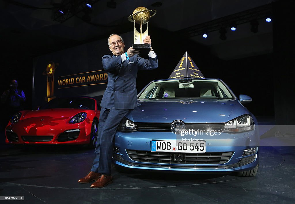 Volkswagen design chief Walter de Silva hoists a trophy into the air after the Volkswagen Golf was named the 2013 World Car of the Year at the New York Auto Show on March 28, 2013 in New York City. It was the second consecutive year that Volkswagen has won the prestigious title.