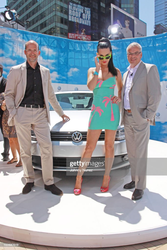 Volkswagen designer Klaus Bischoff, Katy Perry and Volkswagen CEO Stefan Jacoby attend the world premiere of Volkswagen's new compact sedan at Blue Fin in W New York - Time Square on June 15, 2010 in New York City.