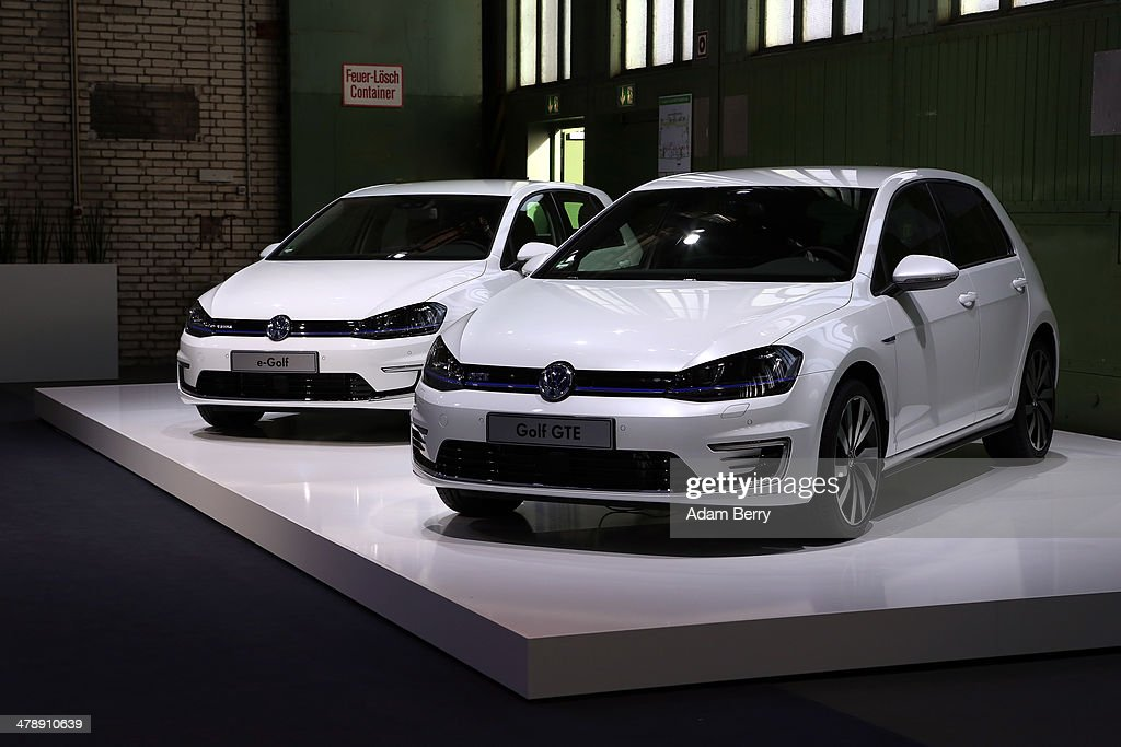 Volkswagen e-Golf and Golf GTE automobiles sit on display at the Electric Mobility Week (e-Mobilitaetswochen), a public Volkswagen (VW) event at the former Tempelhof airport, on March 15, 2014 in Berlin, Germany. The event was designed to promote the company's e-Golf und e-up! automobiles, as well as its other alternative energy powered vehicles.