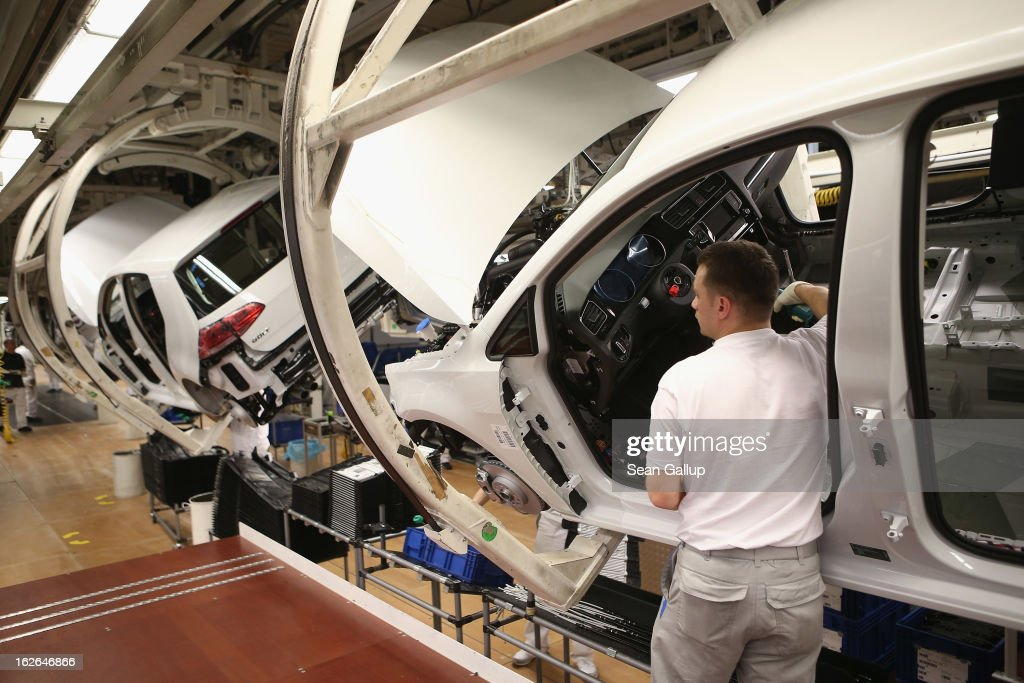 A Volkswagen employee assembles a VW Golf VII car at the Volkswagen factory on February 25, 2013 in Wolfsburg, Germany. Volkswagen will announce financial results for 2012 on March 14.