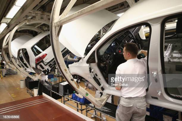 Volkswagen employee assembles a VW Golf VII car at the Volkswagen factory on February 25 2013 in Wolfsburg Germany Volkswagen will announce financial...