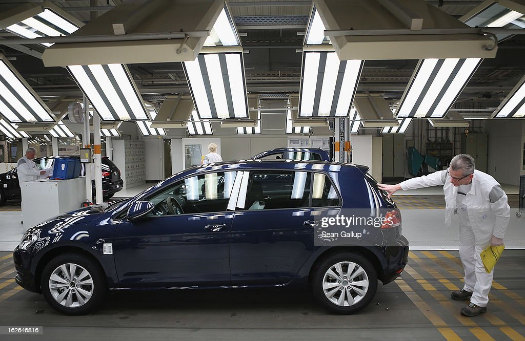 A Volkswagen employee does a final check on a new VW Golf VII car at the Volkswagen factory on February 25, 2013 in Wolfsburg, Germany. Volkswagen will announce financial results for 2012 on March 14.