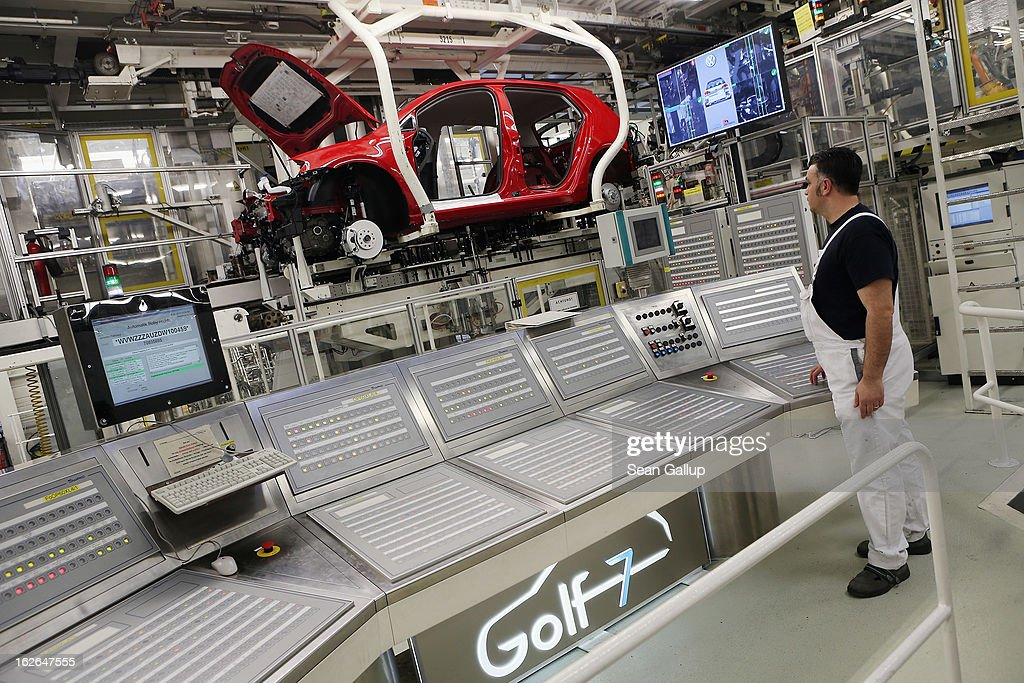 A Volkswagen employee oversees production of new VW Golf VII cars at the Volkswagen factory on February 25, 2013 in Wolfsburg, Germany. Volkswagen will announce financial results for 2012 on March 14.