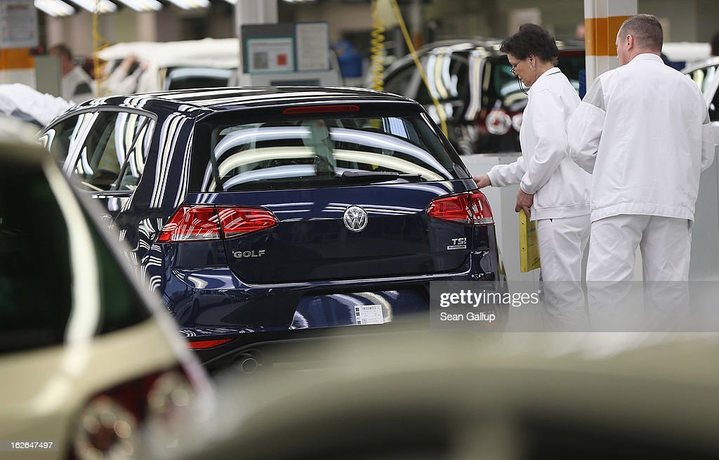 Volkswagen employees do a final check on a new VW Golf VII car at the Volkswagen factory on February 25, 2013 in Wolfsburg, Germany. Volkswagen will announce financial results for 2012 on March 14.