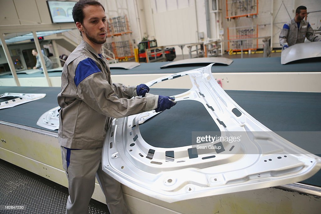 Volkswagen employees stack stamped car body parts for new VW Golf VII and Tiguan cars at the Volkswagen factory on February 25, 2013 in Wolfsburg, Germany. Volkswagen will announce financial results for 2012 on March 14.