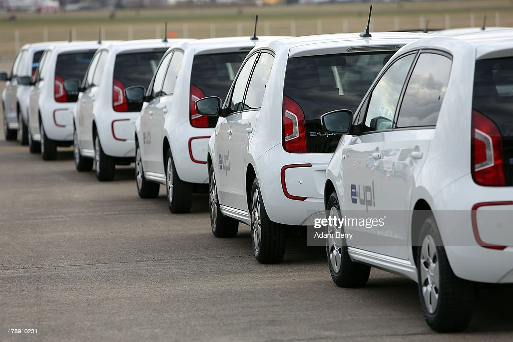 Volkswagen e-up! electric automobiles sit in a row at the Electric Mobility Week (e-Mobilitaetswochen), a public Volkswagen (VW) event at the former Tempelhof airport, on March 15, 2014 in Berlin, Germany. The event was designed to promote the company's e-Golf und e-up! automobiles, as well as its other alternative energy powered vehicles.