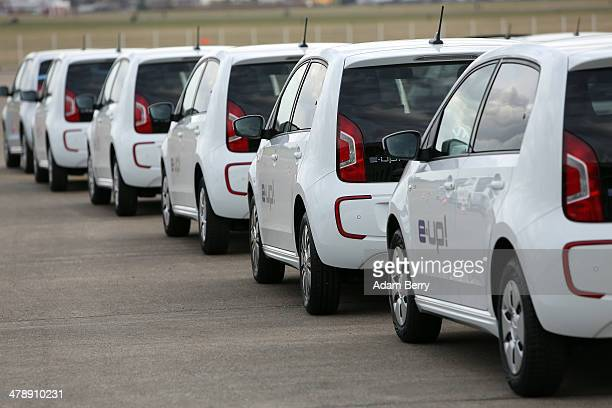 Volkswagen eup electric automobiles sit in a row at the Electric Mobility Week a public Volkswagen event at the former Tempelhof airport on March 15...