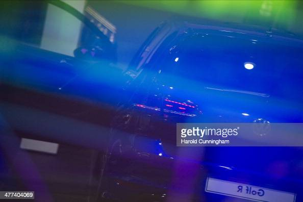 Volkswagen Golf is reflected during the press day of the 84th International Motor Show which will showcase novelties of the car industry on March 5...